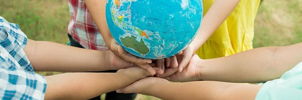 multiple children, hands together, holding a globe